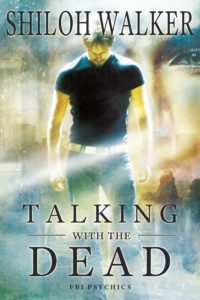 Man in black t-shirt and jeans, looking don. Otherwordly background with a woman's face superimposed over it. Shiloh Walker FBI Psychics Psychic Romance.