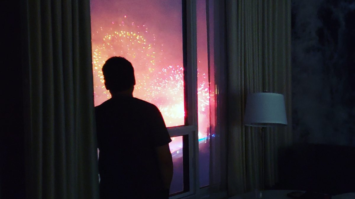 The guy watching Niagara Falls, silhouetted against the window