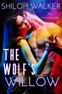 cover of The Wolf's Willow, man and woman embracing, wolf superimposed on front